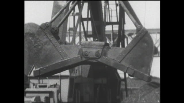 power shovels unload coal from cargo ships at the port of nagoya. - coal stock videos and b-roll footage