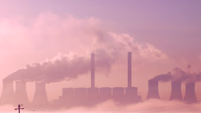 power station burning coal at dawn in south africa - provinz mpumalanga stock-videos und b-roll-filmmaterial