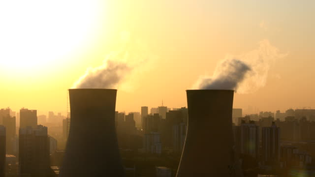 Power station chimneys at sunset
