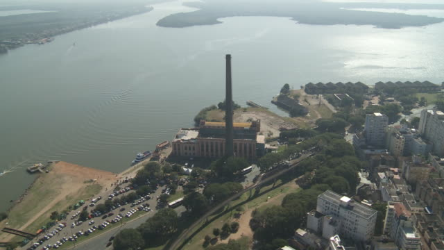 A power station faces a river in Porto Alegre, Brazil.