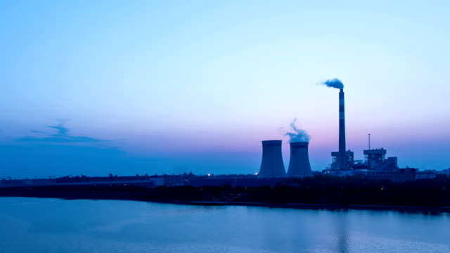 power station generating electricity dusk to night,time lapse. - nuclear reactor stock videos and b-roll footage
