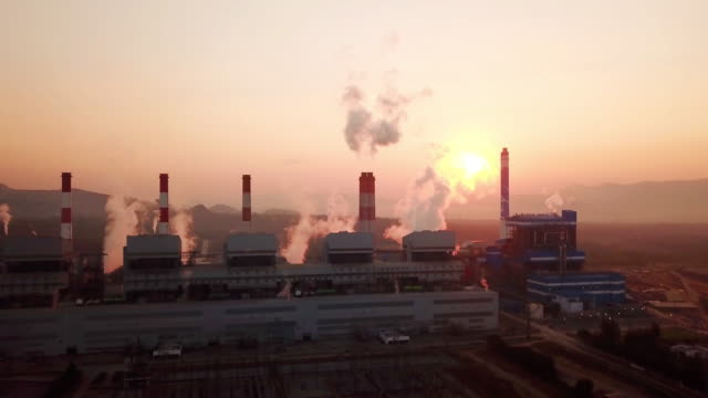 power station with smoking chimneys at sunrise time - coal stock videos & royalty-free footage