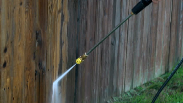 power washing a wooden fence - fence stock videos & royalty-free footage