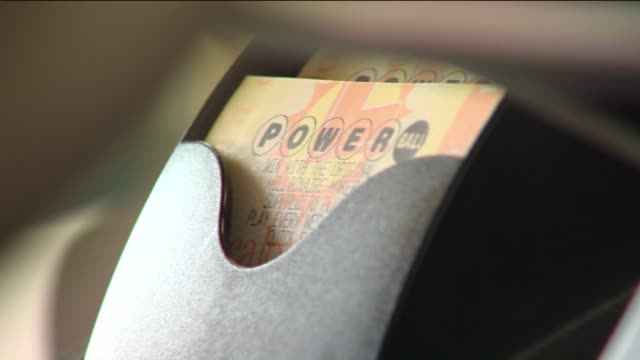 stockvideo's en b-roll-footage met powerball lottery ticket prints out of machine. - loterijlootje