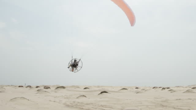 Powered Paragliding Taking Off On Beach