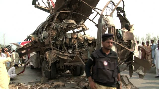 powerful bomb tore through a bus carrying government workers in restive northwest pakistan on friday, killing at least 18 people, officials said... - peshawar stock videos & royalty-free footage