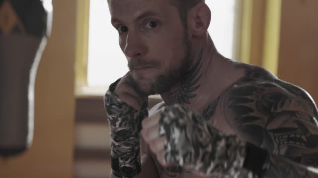 powerful boxer with tattoos - torso stock videos & royalty-free footage