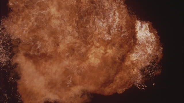 A powerful explosion creating a fireball.