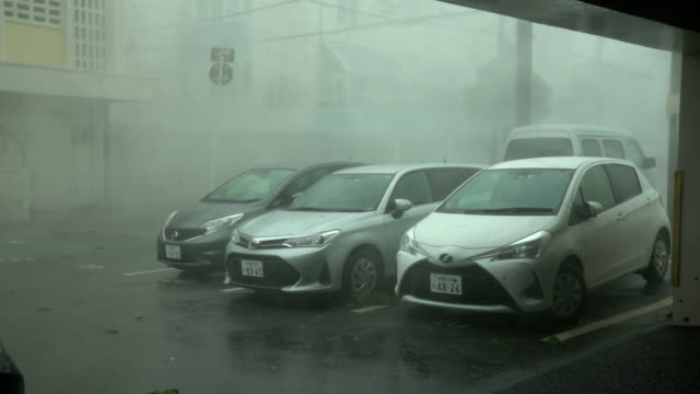 powerful eyewall wind and rain from typhoon lingling lashes miyakojima in japan - parking stock videos & royalty-free footage