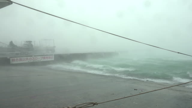 powerful hurricane force winds whip up sea spray in harbor as typhoon maria hits japan in july 2018 - boundary stock videos & royalty-free footage