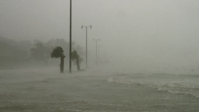 powerful hurricane storm surge flooding highway. - storm surge stock videos & royalty-free footage
