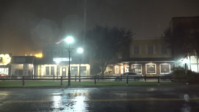A powerful night time nor'easter on Long Island dumps torrential rain on the town of Amityville New York