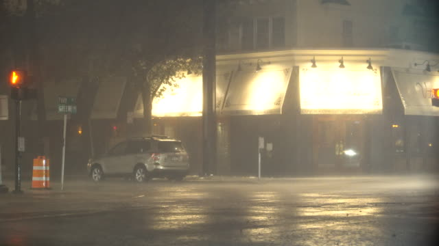 A powerful night time nor'easter on Long Island dumps torrential rain causing street flooding in the town of Amityville New York