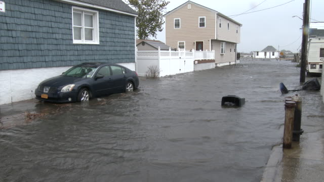 A powerful nor'easter causes storm surge to inundate homes and vehicles in the town of Broad Channel New York