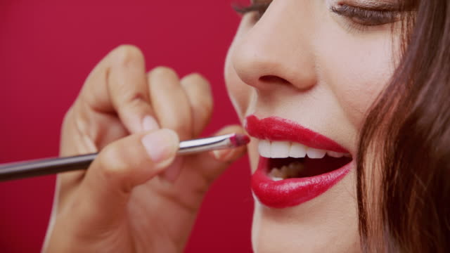 powerful red for a powerful pout - lipstick stock videos & royalty-free footage