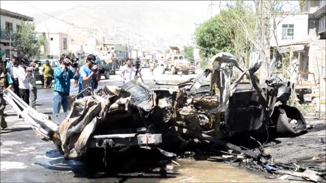a powerful suicide car bomb targeting a nato military convoy in kabul killed eight afghan civilians including two children in the first major attack... - major military rank stock videos and b-roll footage