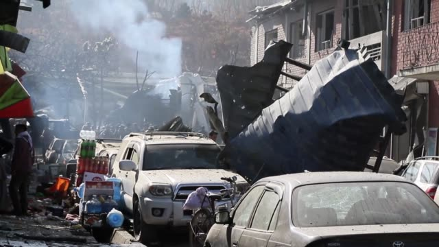 powerful suicide car bombing at the entrance of a government compound in the afghan capital kabul on saturday killed at least 40 people and injured... - kabul stock videos & royalty-free footage