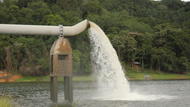 powerful water flowing from a large water pipe in dam - pipe stock videos & royalty-free footage