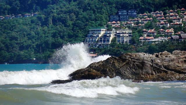 powerful wave curls on tropical island, slow motion - tsunami stock videos & royalty-free footage