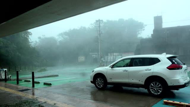 Powerful wind and rain sweep across town as typhoon Trami hits Okinawa Japan