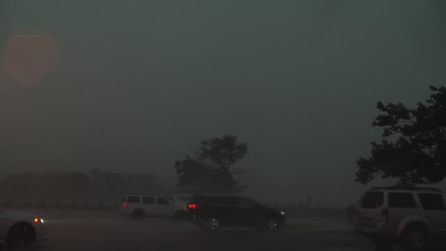 powerful winds caused by a thunderstorms microburst tear through a parking lot at the north channel bridge in howard beach queens new york new york - scott mcpartland stock videos & royalty-free footage