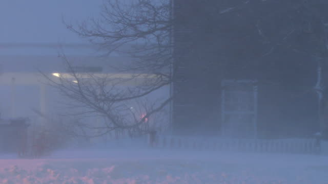 Powerful winds combined with heavy snow create near whiteout conditions during a New England blizzard