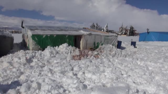 a powerful winter storm named 'huda' or 'zina' worsens the living conditions of syrian refugees who fled their homes due to the civil war in their... - lebanon country stock videos & royalty-free footage