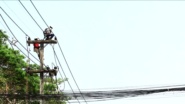powerline workers , chiangmai thailand - high up stock videos & royalty-free footage