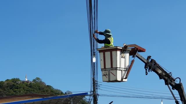 powerline workers - technician stock videos & royalty-free footage