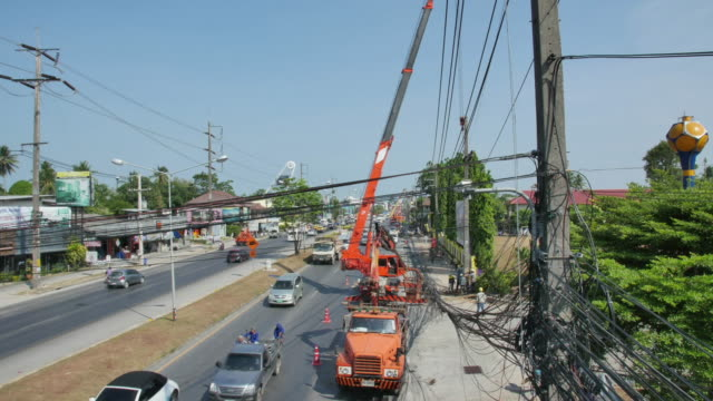 powerline workers.(4k time-lapse) - telegraph pole stock videos and b-roll footage