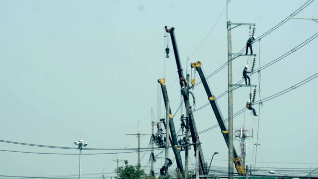 powerline workers - telegraph pole stock videos and b-roll footage