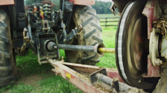 a pto (power take-off shaft) powers a tool on the back of a tractor in a farm - tractor stock videos & royalty-free footage