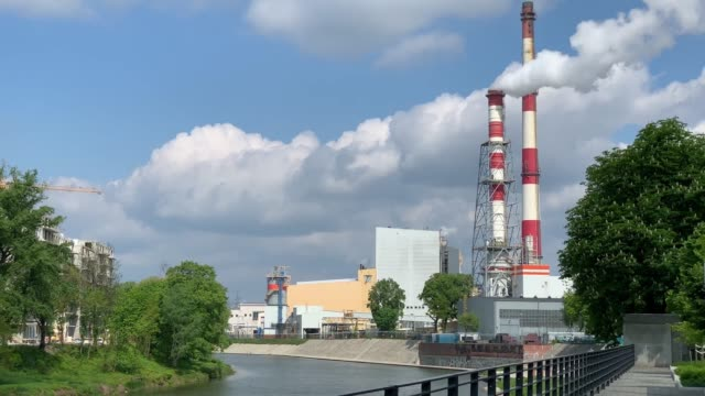 Power-station chimney emits toxic gas in city