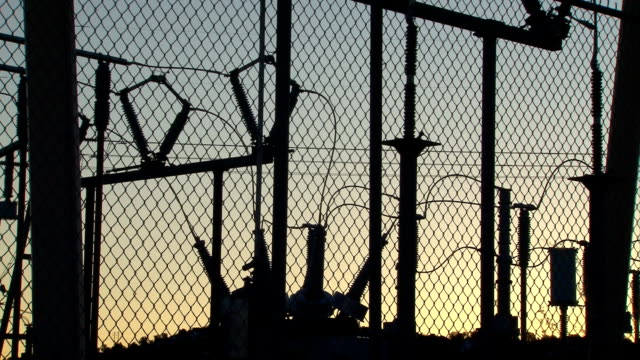powerstation transformer silhouette - chainlink fence stock videos and b-roll footage
