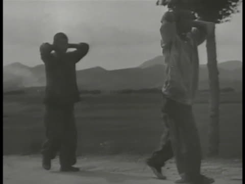 pows walking road w/ hands behind head one male carrying another - hands behind head stock videos & royalty-free footage