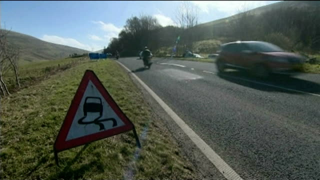 tributes paid to four victims; wales: powys: a470: ext traffic along road where crash happened police sign 'collision' appealing for witnesses floral... - 中央ウェールズ点の映像素材/bロール