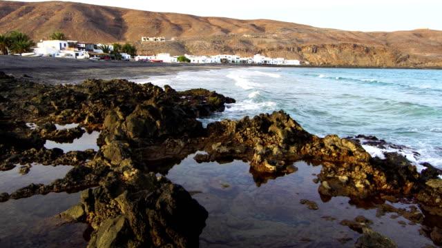 pozo negro beach, fuerteventura - rocky coastline stock videos & royalty-free footage
