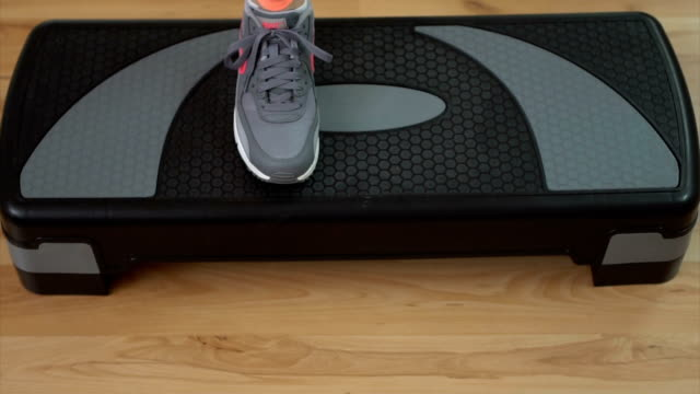practice on aerobic stepper - step aerobics stock videos & royalty-free footage