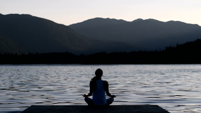 practicing a healthy lifestyle through yoga - lake stock videos & royalty-free footage