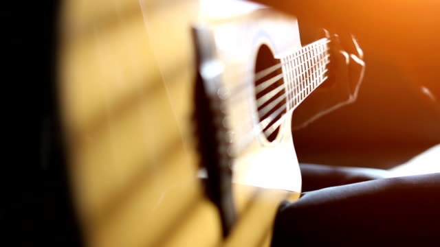 practicing acoustic guitar - side lit stock videos & royalty-free footage