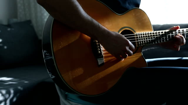 practicing acoustic guitar - guitarist stock videos & royalty-free footage