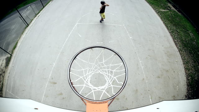 hd super slow-mo: practicing free throw from a line - shooting baskets stock videos and b-roll footage