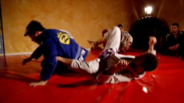 Practicing jujitsu techniques