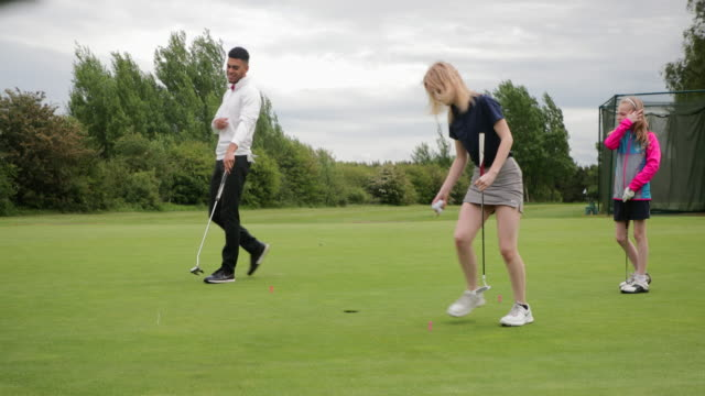practicing putting her ball - golf bag stock videos & royalty-free footage