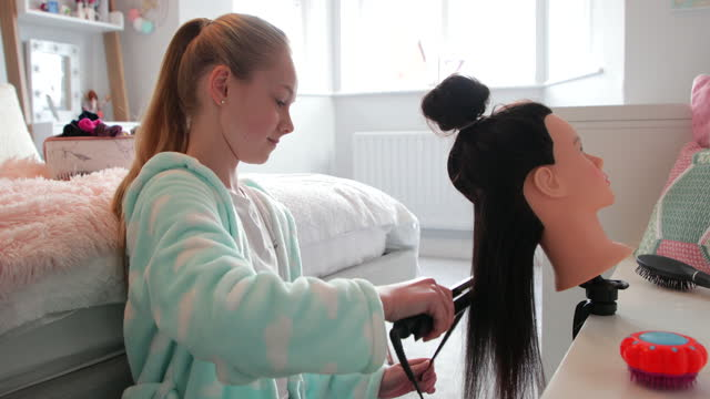 practicing to be a hairdresser! - bathrobe stock videos & royalty-free footage