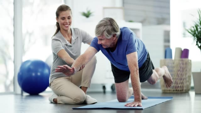 practising activities that challenge balance - osteoporosis stock videos & royalty-free footage