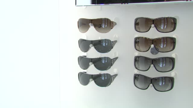 prada sunglasses at the prada and sunglass hut open the first temporary eyewear concept store at new york ny. - store opening stock videos & royalty-free footage