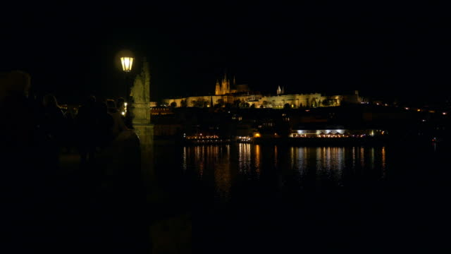 prague charles bridge and hradcany at night - mala strana stock videos and b-roll footage
