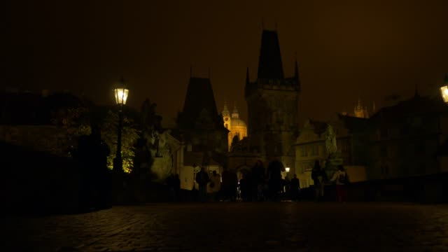 prague charles bridge and mala strana at night - mala strana stock videos and b-roll footage