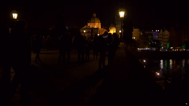 prague charles bridge and old town at night - stare mesto stock videos & royalty-free footage